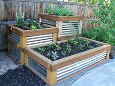 white wooden garden trough planter veg bed flower plant pots in