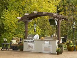 custom designed outdoor rooms wood fireplace kitchen islands