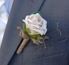 wedding flowers buttonholes artificial chagne mocha wedding guest buttonhole with