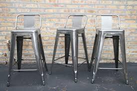 metal high bar stool in black finished having backrest using