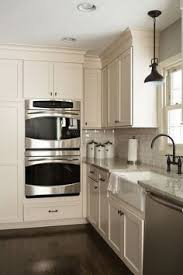 Off White Kitchen Cabinets by Off White Kitchen With Grey Quartz Countertop The Surrounding
