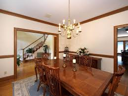 dining room with chair rail craftsman dining room with chandelier u0026 crown molding in fort mill