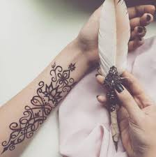 henna feather tattoo
