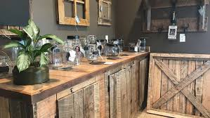 a rustic piece of home new furniture and decor shop open on lake