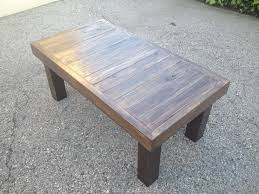 tasteful mahogany dark polished reclaimed wood coffee table with