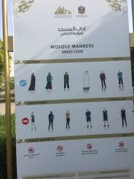 strict dress code before entering picture of sheikh zayed mosque
