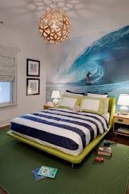 bedroom stylish bed frame back to ocean wall painting and flanked bedroom stylish bed frame back to ocean wall painting and flanked with nightstand light illuminated with