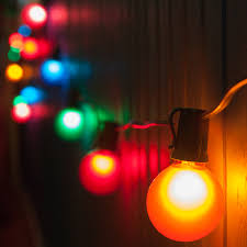 Fixing Christmas Lights String by Patio Doors Outdoor Lighting On Summer Night Out Door Patio