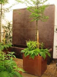 courtyard garden with rendered water wall and copper planters