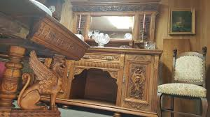 elaborately carved victorian dining room table and chairs and