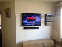 home theater installation charlotte flat screen tv installation with soundbar and floating av shelves