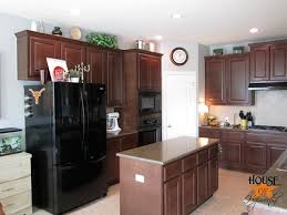 kitchen on top of cabinets how to decorate the top of your cabinets an easy trick