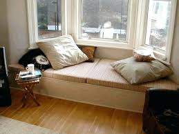 wall hung headboard bedroom grey sofa carpet floor cream fabric
