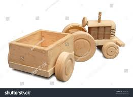 wooden truck toy wood toy wheeled tractor trailer isolated stock photo 4021285