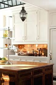 copper backsplash for kitchen copper backsplash plain white cabinets are up with a polished