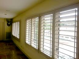 Interior Shutters For Windows Wood Cased Windows Are No Problem For Plantation Shutters Window