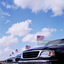 Car Bonnet Flags Row Of Cars With American Flags On Bonnets Stock Photo Getty Images