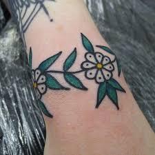 cute old daisy flower bracelet tattoo on wrist tattoos pm