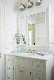 Industrial Style Bathroom Vanities by White Beach Style Bedroom With Three Industrial Sconces Cottage