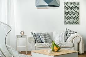 how to make a small living room look bigger is by choosing neutral