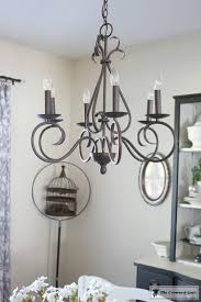 Simple Chandelier Adding Greenery To Simple Chandeliers The Crowned Goat