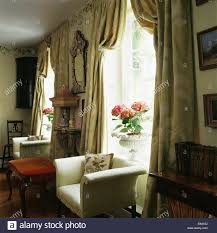 Country Living Room Curtains Cream Armchair In Front Of Window With Heavy Silk Curtains In