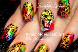 rainbow leopard face nails fierce animal print nails design