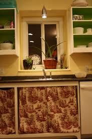 poorly hung toile cloth cabinet curtains instead of doors more