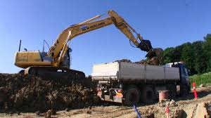 volvo trucks holland loading volvo 8x4 truck with new holland e215b excavator youtube