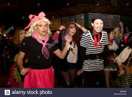 new york city halloween parade a man dressed as a woman and a woman dressed as a man participate