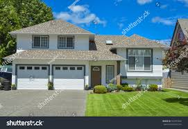 Two Door Garage by Family House Lawn On Front Blue Stock Photo 162977249 Shutterstock