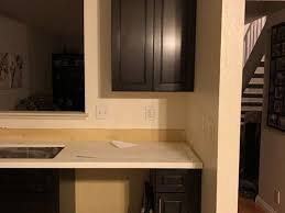 how to put filler on kitchen cabinets does top and bottom cabinet filler need to match