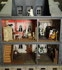 this person customized a playmobil doll house to create a haunted