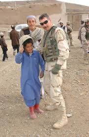 A young Afghan boy gives the