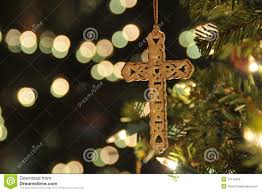 cross ornament on christmas tree royalty free stock images image