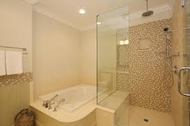 modern full bathroom with frameless showerdoor u0026 handheld shower