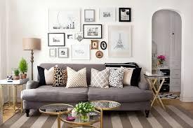 grey sofa living room ideas on your companion alaina kaczmarski s lincoln park apartment tour the everygirl