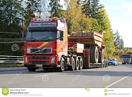 volvo truck trailer volvo truck hauls construction machinery as wide load editorial