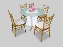 canterbury round glass dining table is available for rent or sale