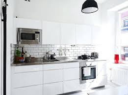 black and white subway tile backsplash white kitchen cabinets