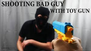 Nerf Meme - kid shoots robber with toy gun trying to steal dank memes nerf