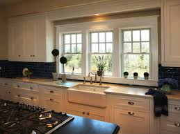 kitchen sink backsplash small bay window above kitchen sink gray cut pile rug gray tile