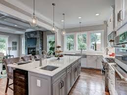 Gray Pendant Light Kitchen Great Room Double Ovens Gray Walls White Countertops