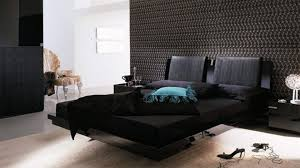 modern masculine bedroom white sheet and dark accent wall black