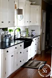 White Kitchen Cabinets With Black Granite Countertops by Decorating Dear Lillie Kitchen With Pendant Lighting And White