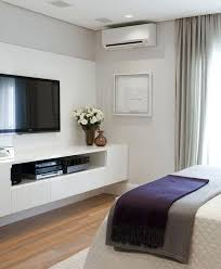wall mounted tv ideas bedroom what to put under wall mounted large
