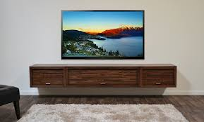 brown wooden cabinet and rectangular led tv floating on white wall