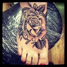 8 black and white rose tattoos on foot