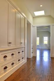 a wall of built in cabinets provides plenty of room to store