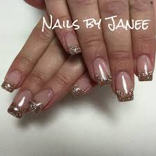 champagne glitter gel nails by janee at a wild hair salon best